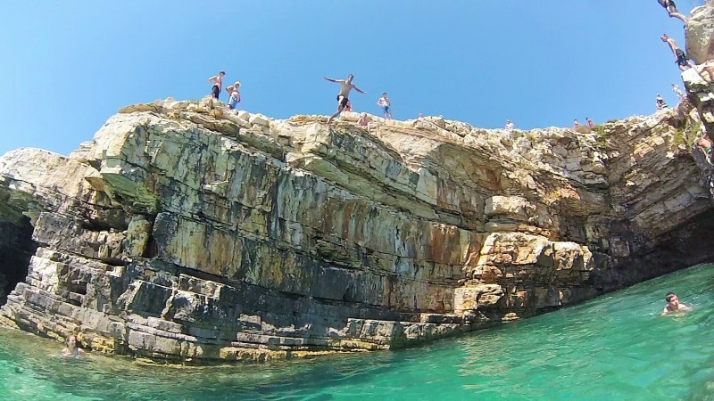 Cliff jumping in Kamenjak