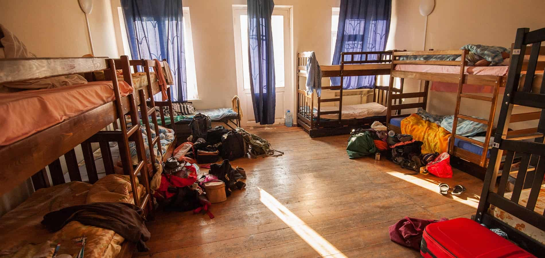 Travel with little money and stay in dorms